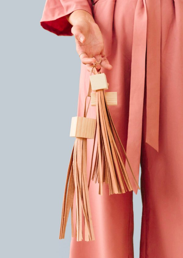 Block Head: DIY Statement Tassels Made with Wood Blocks and Leather. Click through for the tutorial.
