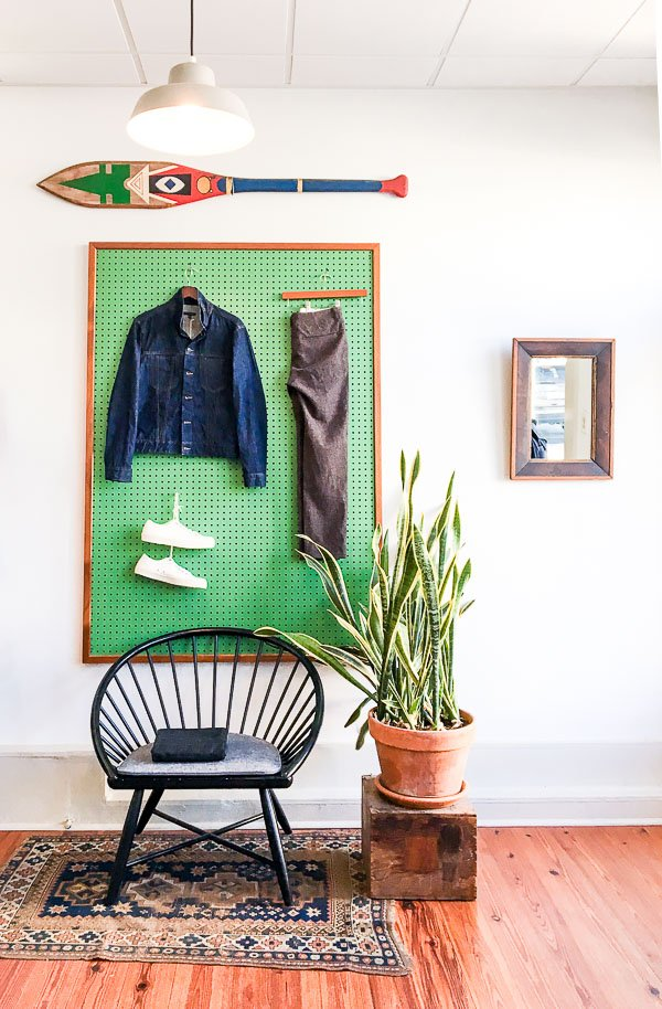 Painted pegboard for displaying clothing