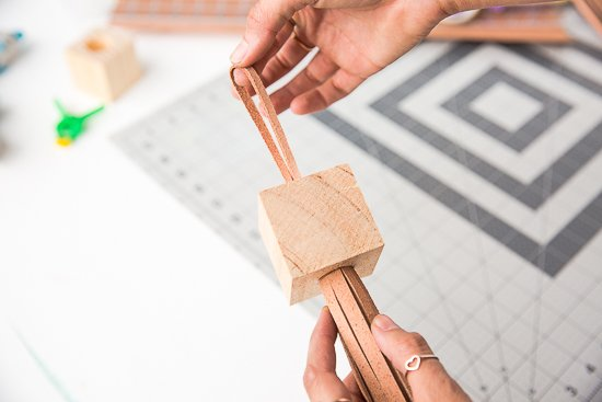Block Head: DIY Statement Tassels Made with Wood Blocks and Leather