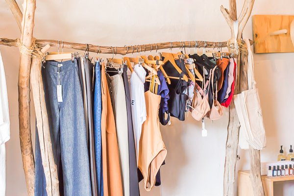 Use medium size branches to create a clothing rack.