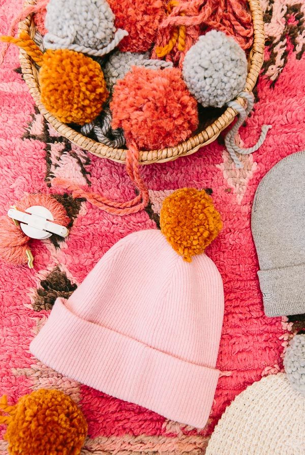 How to make DIY pom pom beanies for fall and winter. Click through for the tutorial.