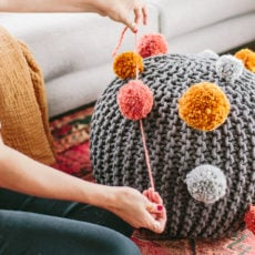 Make a DIY Pom Pom Ottoman / Pouf for Fall