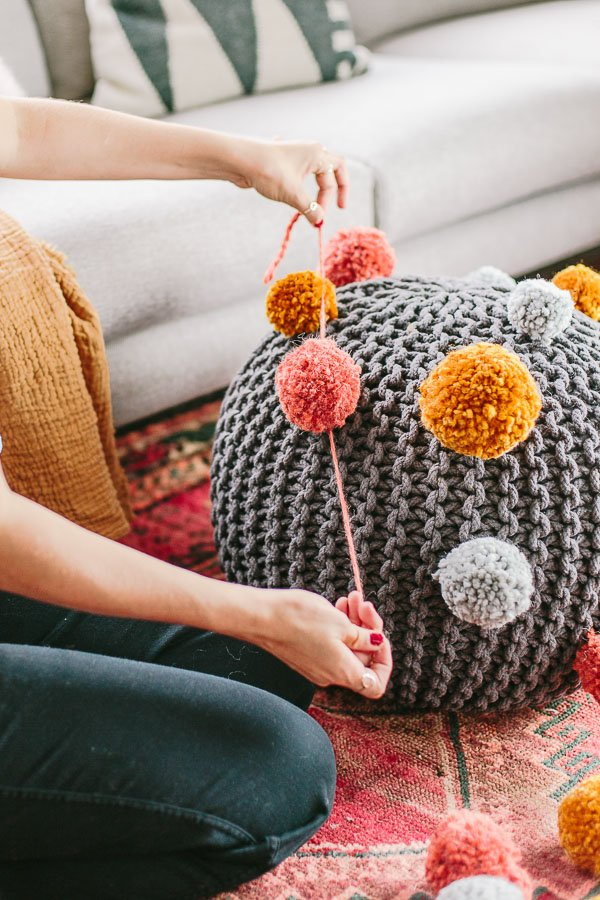 How to make a pom pom ottoman for fall. #decorate #ottoman #diy #fall