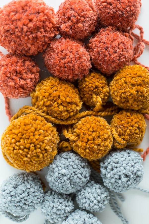 How to make DIY pom poms. Love these fall colors.