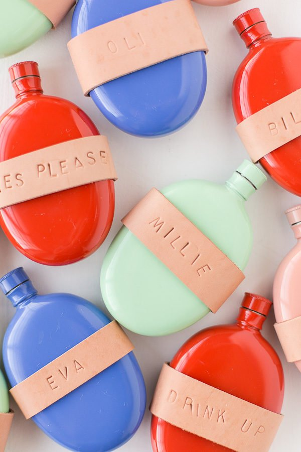 DIY leather wrapped (and stamped) flasks! These would make awesome stocking stuffers and holiday gifts for friends. #stockingstuffers #colorful #christmas #holiday