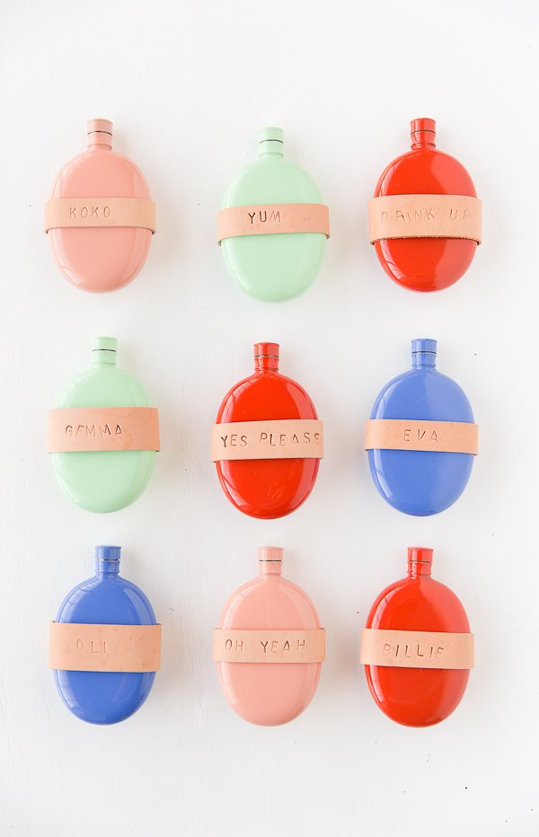 Ready for a DIY Holiday Gift Idea? Check out this one for a (stamped) leather-wrapped flask. These are more toward the girlie side, but you could totally recreate a more masculine version for guys with a different flask. #holidaygift #christmas #colorful #leather #stampedleather #giftideas #gift #christmasgift #stockingstuffers