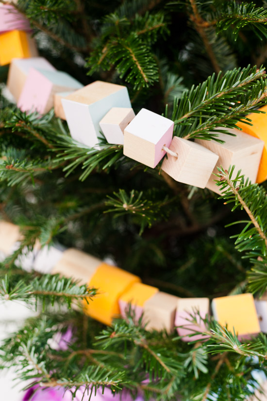 DIY wood garland wrapped around a Christmas tree