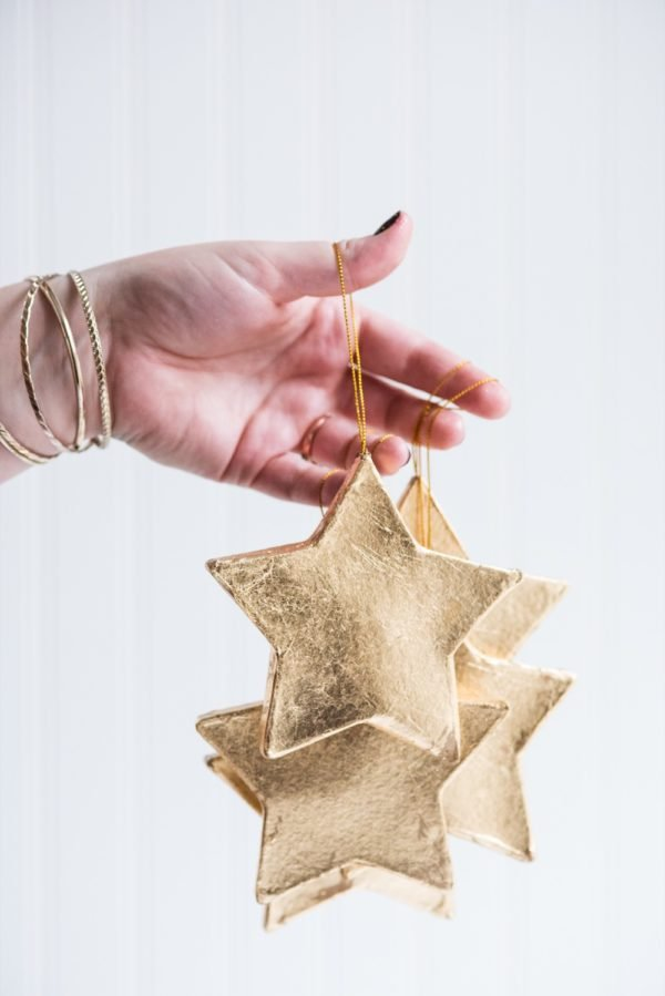 Click through for this golden star ornaments DIY and a whole bunch of other DIY holiday ornaments to try before Christmas! #ornaments #tassels #holiday #christmas #diy