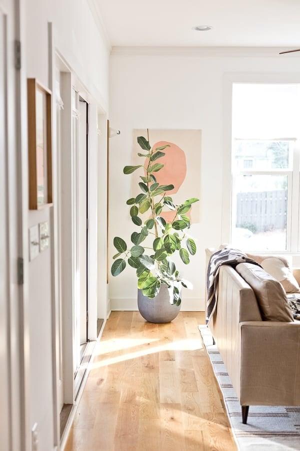 DIY artwork on canvas, hanging in a light-filled living room.