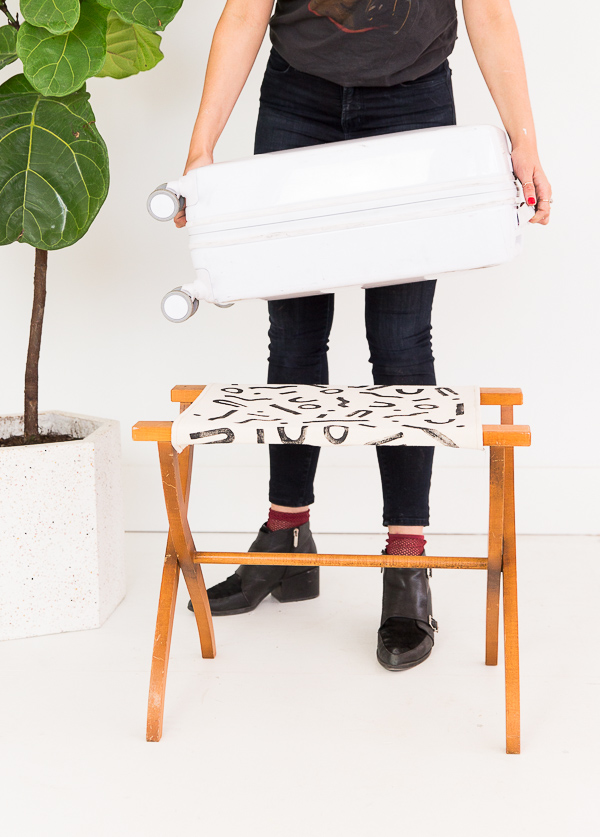 Get ready for guests all season long with a handsewn, handstamped DIY luggage rack! #luggagerack #travel #diy #tutorial #blockprinting #blockprint #linoblock #handstamped