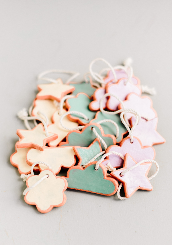 DIY clay ornaments in various pastel colors and shapes