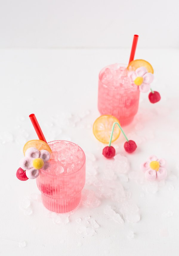 Spiked cherry lemonade cocktails. A little sweet, a little sour, and delicious! Click through for the recipe. #cocktail #cocktailrecipe #pink #valentinesday #valentine #candycocktail