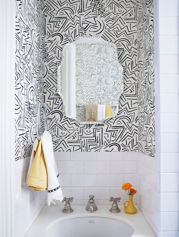 Create interest to your bathroom by adding a fun pop of wallpaper. Want to find out other ways to makeover your bathroom? Check out 13 Easy Ways to Freshen Up Your Bathroom. #paint #bathroom #interiors #tips #makeover #affordable #bathroomupgrade #vanity #wallpaper #blackandwhite