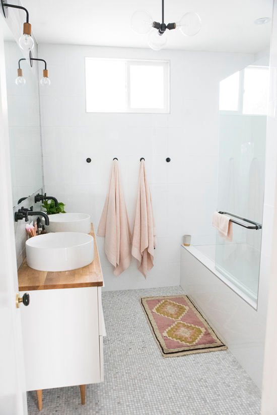 For a simple way to update your bathroom, try switching out your old linens for something brighter. Want to find out other ways to makeover your bathroom? Check out 13 Easy Ways to Freshen Up Your Bathroom. #vanity #hardware #bathroom #interiors #tips #makeover #affordable #bathroomupgrade #pink #linens