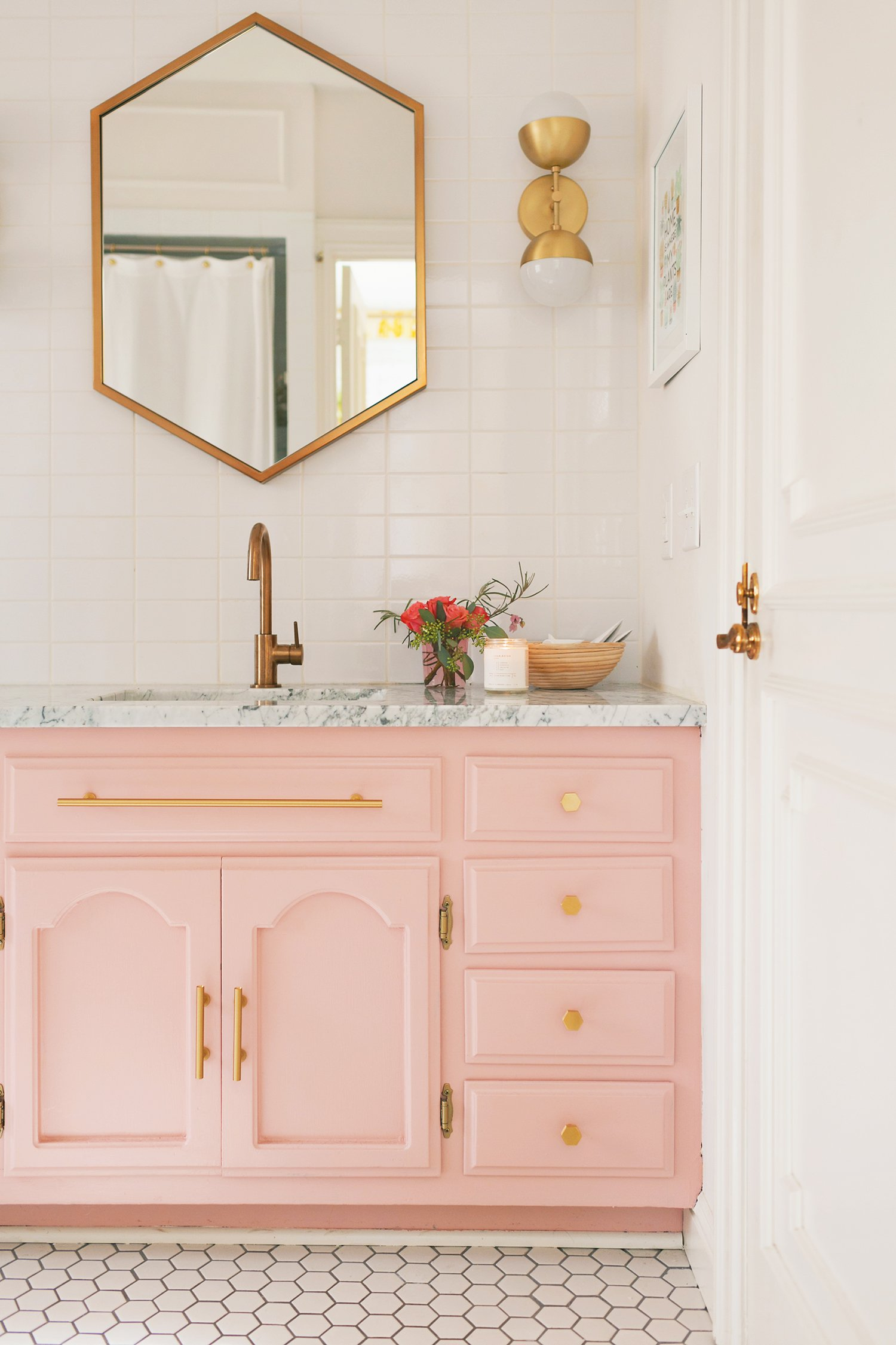 For an affordable bathroom upgrade, consider painting your vanity a fun, fresh color. Want to find out other ways to makeover your bathroom? Check out 13 Easy Ways to Freshen Up Your Bathroom. #paint #bathroom #interiors #tips #makeover #affordable #bathroomupgrade #pink #vanity