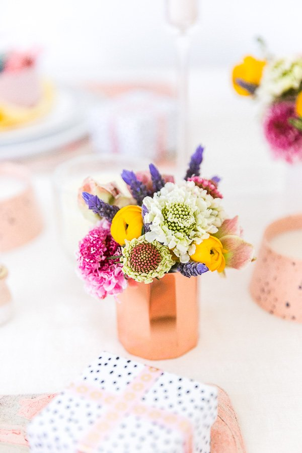Spring Entertaining Idea: Make small floral centerpieces to scatter throughout the table, amongst candles. Click through for all 6 simple tablescape ideas for spring and Easter entertaining. #entertaining #modernentertaining #easter #pastels #flowerpower #floralcenterpiece #diy