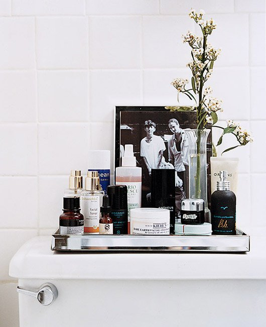 The first step to any bathroom makeover is to declutter. Check out 12 ways to give your bathroom a budget-friendly refresh. #vanity #bathroom #tips #makeover #declutter #organize #cosmetics