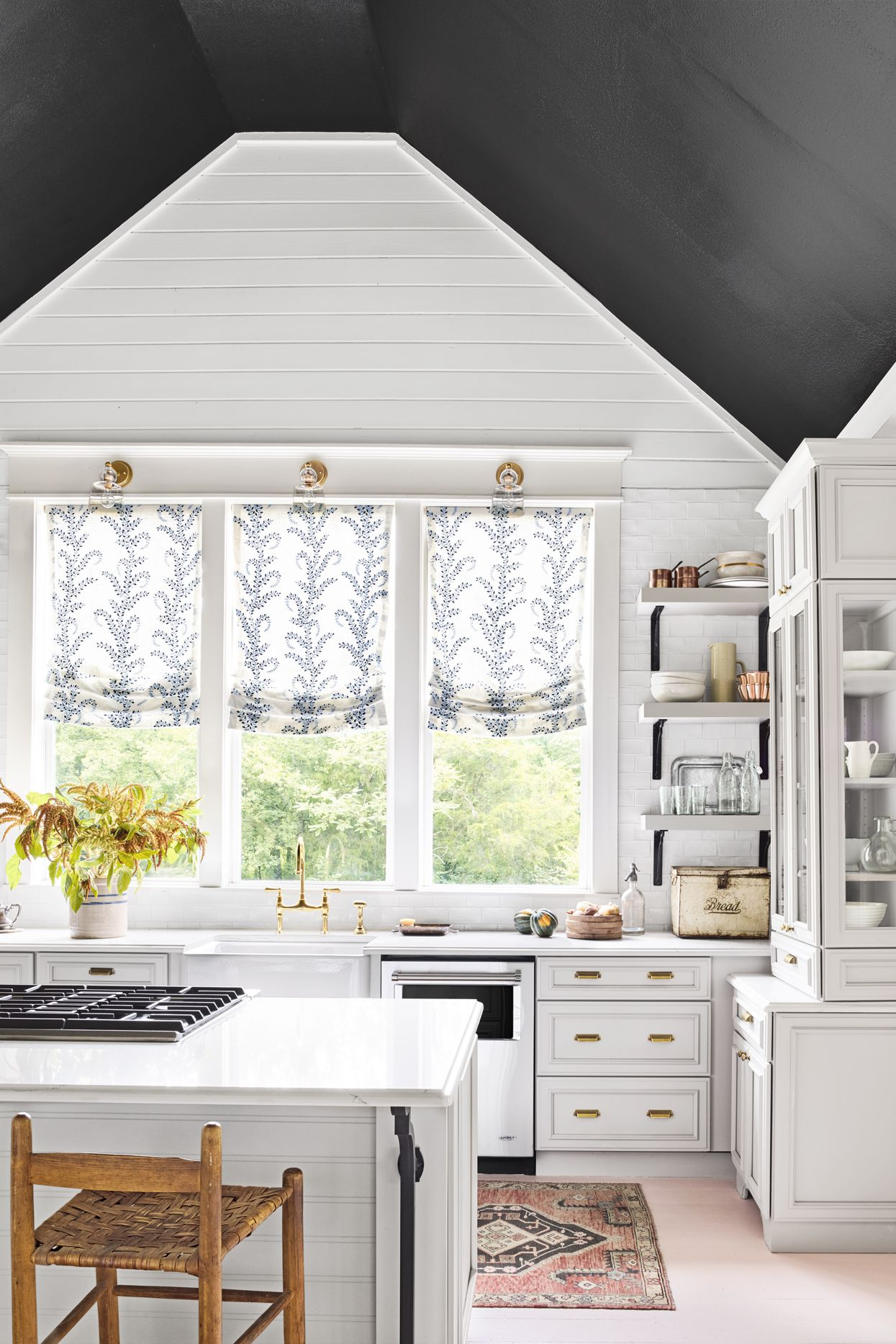 Holly Williams' house showcases original vaulted ceilings painted black. Are you a fan of the painted ceiling trend? Join the debate! #ceilings #paintedceilings #trend #interiors