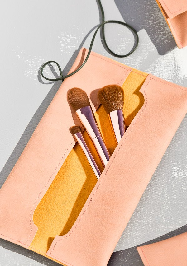 DIY makeup pouch. Learn how to make leather sewn pouches three different ways with this tutorial. Click through! #diygift #diy #sewing #sewingtutorial #leather