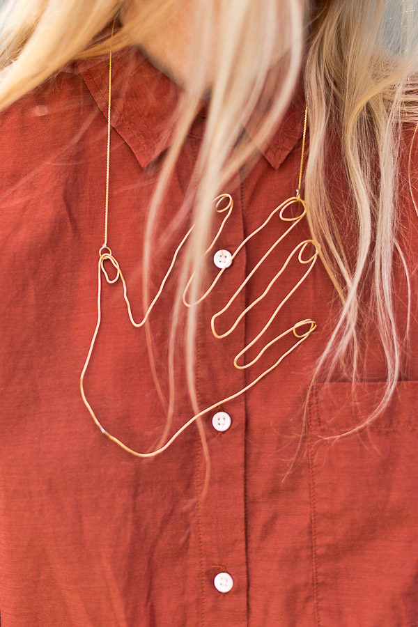 A statment necklace would be a great gift idea for young moms, etc. You could even make the hand the silhouette of your own child. Click through to see all 43 DIY ideas for mom. #mothersday #diygifts #giftsformom