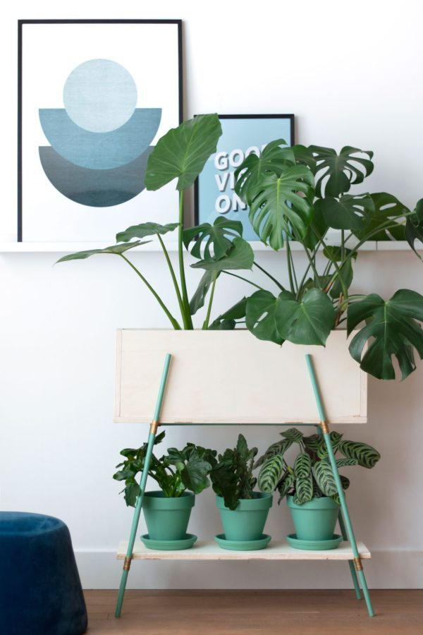 Green DIY plant stand and planters from Enter My Attic. Check out 23 Planters You Can DIY! #plants #diyplanter #planter #pots
