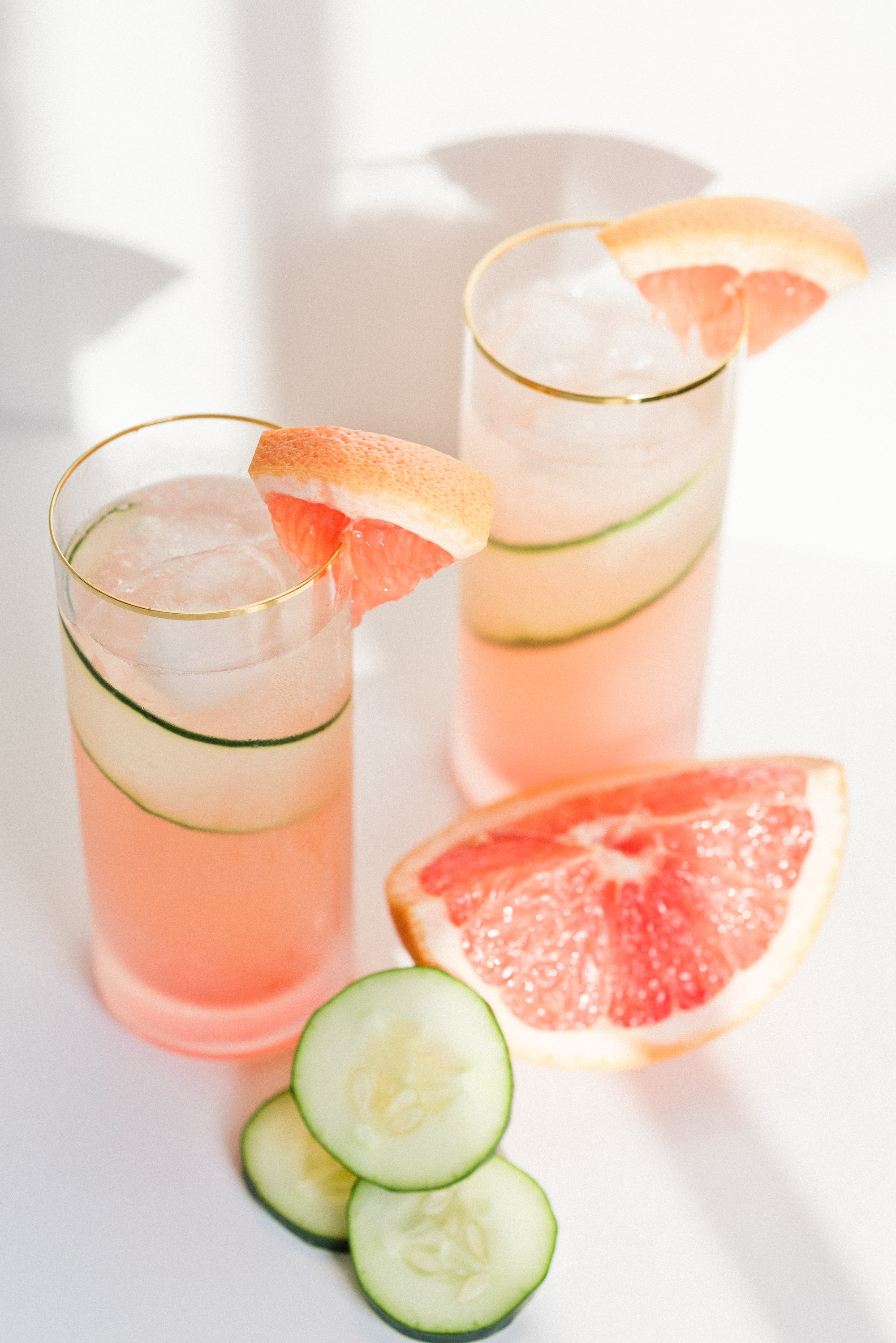 Get in vacation mode with a Grapefruit Cucumber Gin Cooler. Check out the full recipe to make your own. #cocktails #gin #grapefruit #cucumber