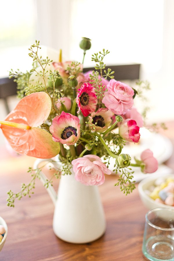 How to throw a (minimal) spring dinner party - add flowers from the grocery store to empty pitchers or vases as centerpieces. #spring #dinnerparty #entertaining #springentertaining