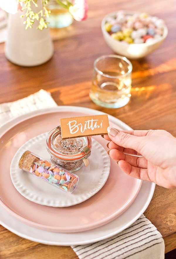 How to throw a (minimal) spring dinner party - create leather place cards for guests. #spring #dinnerparty #entertaining #springentertaining