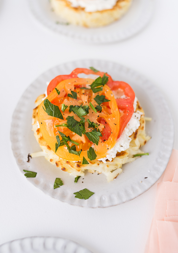 Savory hash brown nests 3 ways at your next brunch (this one is tomato and ricotta). Click through for the recipe! #breakfast #brunch #recipe #hashbrowns #uniquehashbrown