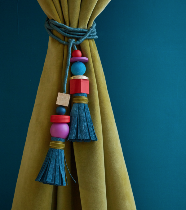 DIY paper and wood curtain tassel tieback from the book Craft the Rainbow (by The House that Lars Built).