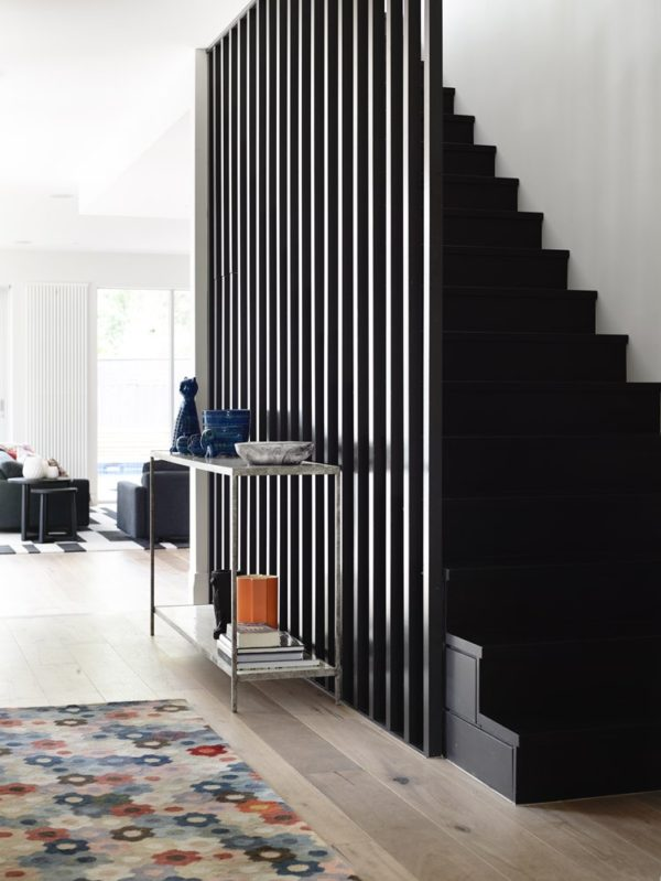 "A modern staircase feature via Mim Design. See how to ""Step Up Your Staircase Game with This Modern Design Trend"" #staircase #stairs #stairscreen #moderndesign"