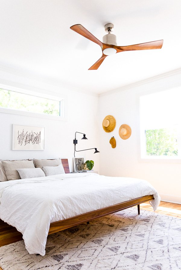An organic modern bedroom makeover, with a muted color palette. This is the home of lifestyle blogger, Brittni Mehlhoff of Paper and Stitch. #interiors #bedroominspo #organicmoderninteriors #organicmodernbedroom #bedroommakeover