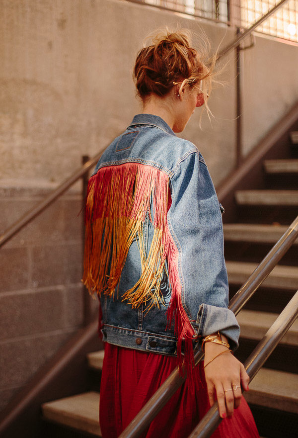 DIY Fringe Denim Jacket Makeover. Check out 13 Ways to Upgrade Denim Clothing. #denim #denimdiy #jeansdiy #fashiondiy