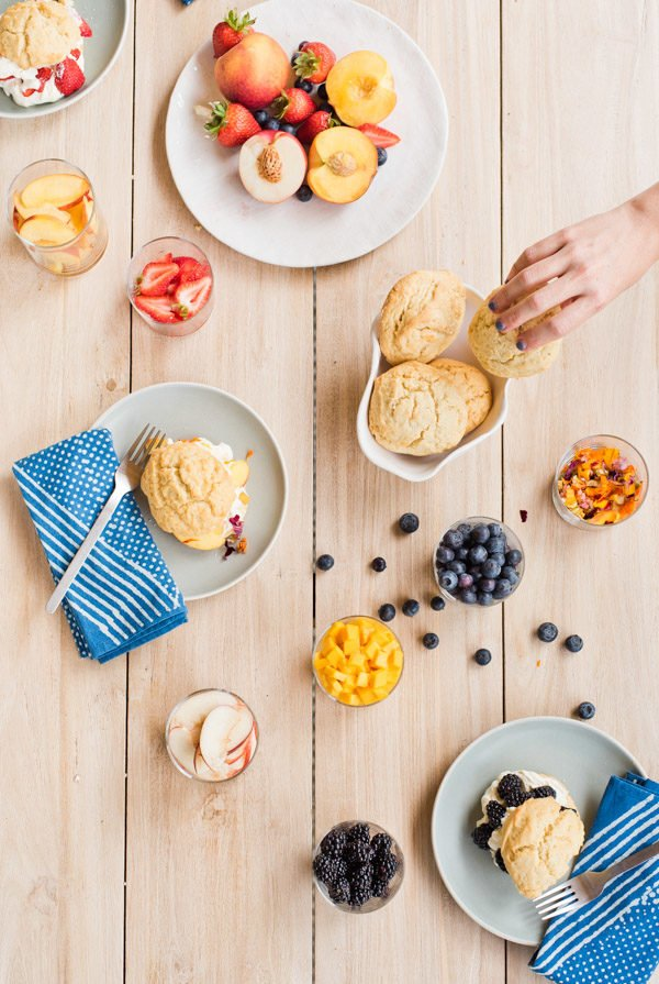 Love this easy shortcake dessert bar for summer entertaining (especially July Fourth). It's filled with fresh fruit and homemade whipped cream...even a few edible flowers. #julyfourth #summerentertaining #dessertbar #yum #summer