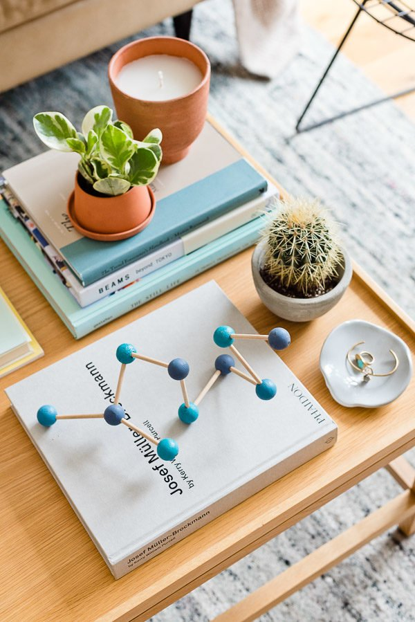 An Eames-inspired home decor project for coffee table and bookcase styling. #interiors #coffeetablestyling #coffeetableinspiration #diydecor #diyhomedecor