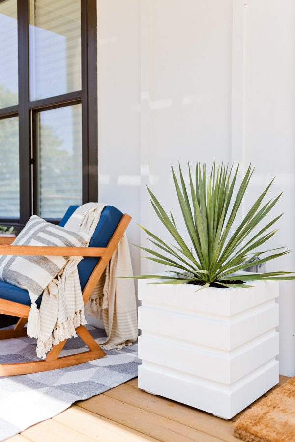 A modern planter and desert plant can go a long way for a front entrance. Click through for the front porch makeover of Brittni Mehlhoff of Paper and Stitch. #frontporchreveal #outdoorreveal #outdoormakeover #frontporchmakeover #beforeafterhome #porchmakeover