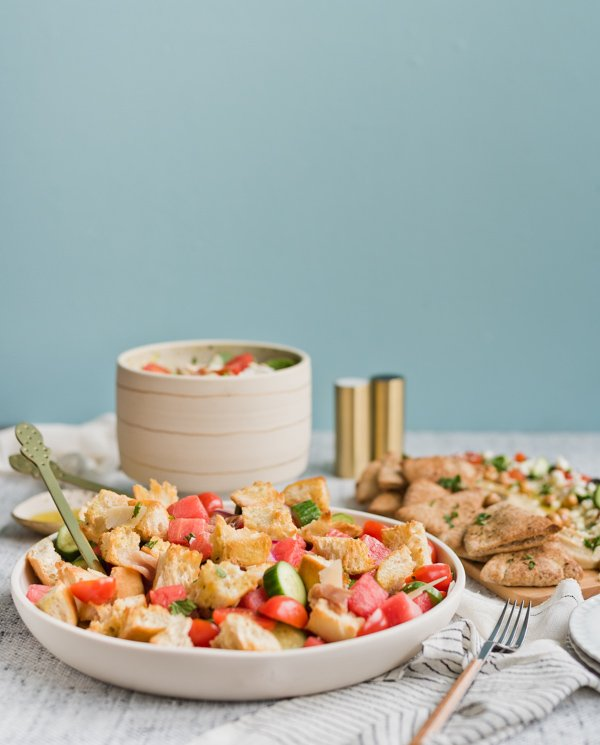 3 easy summer salads perfect for entertaining. Click through for all three recipes from Paper and Stitch. #summersalads #saladrecipe #summerrecipe #panzanellasalad #hummus #hummusboard #zucchininoodlesalad