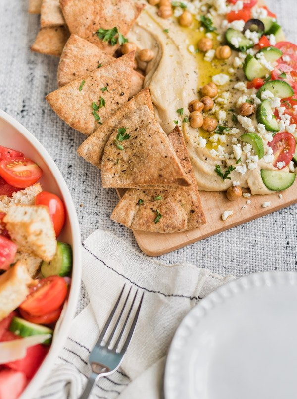 Hummus board recipe for easy summer entertaining. Click through for all three recipes from Paper and Stitch. #summersalads #saladrecipe #summerrecipe #panzanellasalad #hummus #hummusboard #zucchininoodlesalad