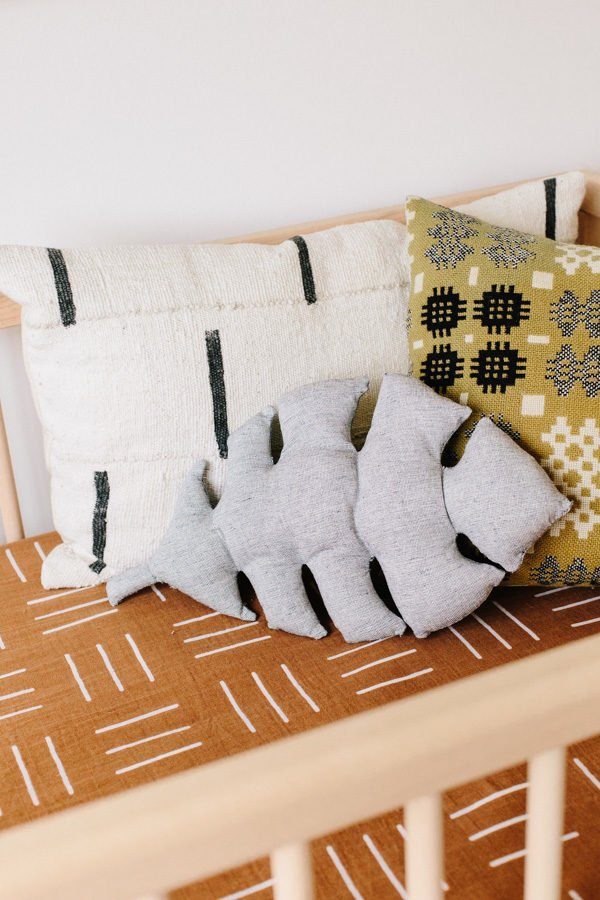 DIY Pillow Idea: Click through to learn how to make a monstera leaf pillow (and a smaller size too). #diypillow #leafpillow #diyhome #diyhomedecor #nurseryinspiration #kidsroom
