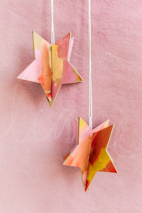 Click through for 3 unique DIY holiday ornament ideas (like this one for 3D star ornaments). #diy #holiday #christmas #diyornament #diyholiday #ornament #watercolor #geoshapes #star