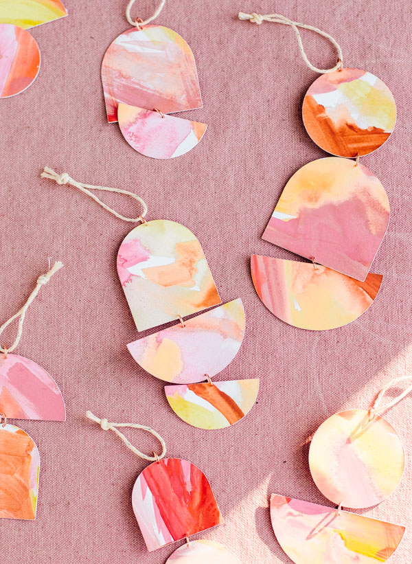 Click through for 3 unique DIY holiday ornament ideas (like this one for geo totem ornaments). #diy #holiday #christmas #diyornament #diyholiday #ornament #watercolor #geoshapes #totem