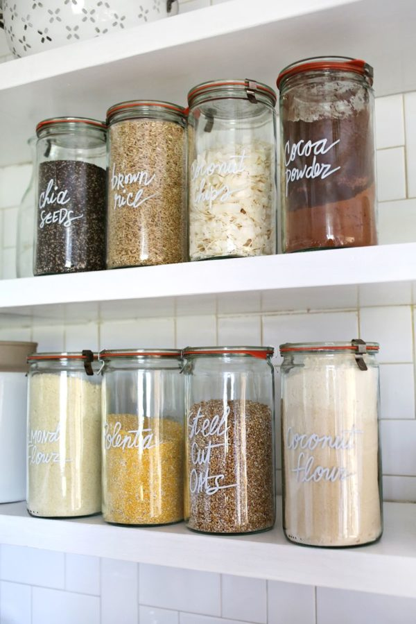 Pantry organization displaying spices and kitchen staples on floating shelves.