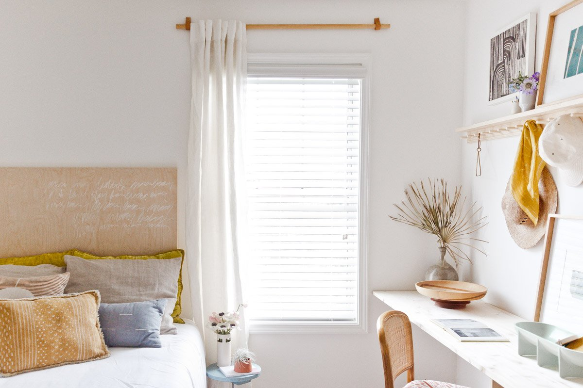 How to make a simple (but cool) curtain rod for less than $10. Click through for the step by step tutorial. #diy #curtainrod #budgetfriendlyinteriors
