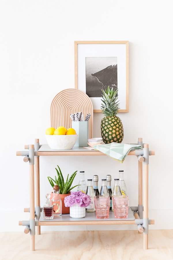 Repurpose your furniture like this bookshelf turned barcart. Check out 8 ways to revamp your furniture. #furniture #makeover #upcycle