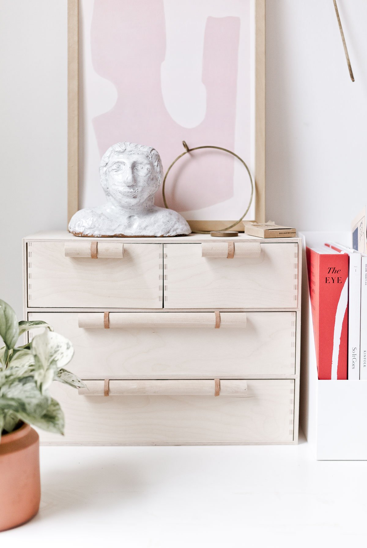 DIY Ikea Hack! Looking for a minimal modern Ikea hack that will elevate your Moppe mini storage chest? Check out this DIY idea that involves making your own custom wood and leather drawers pulls that instantly upgrade one of Ikea's most popular products. #ikeahack #diy #deskorganizer #desk #wooddiy #drawerpulls #diydrawerpulls #minimalmodern #organicmodern