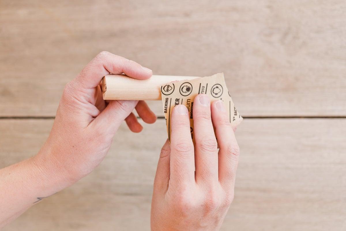 Sanding dowel rods for drawer pulls. #diy #drawerpulls #wood