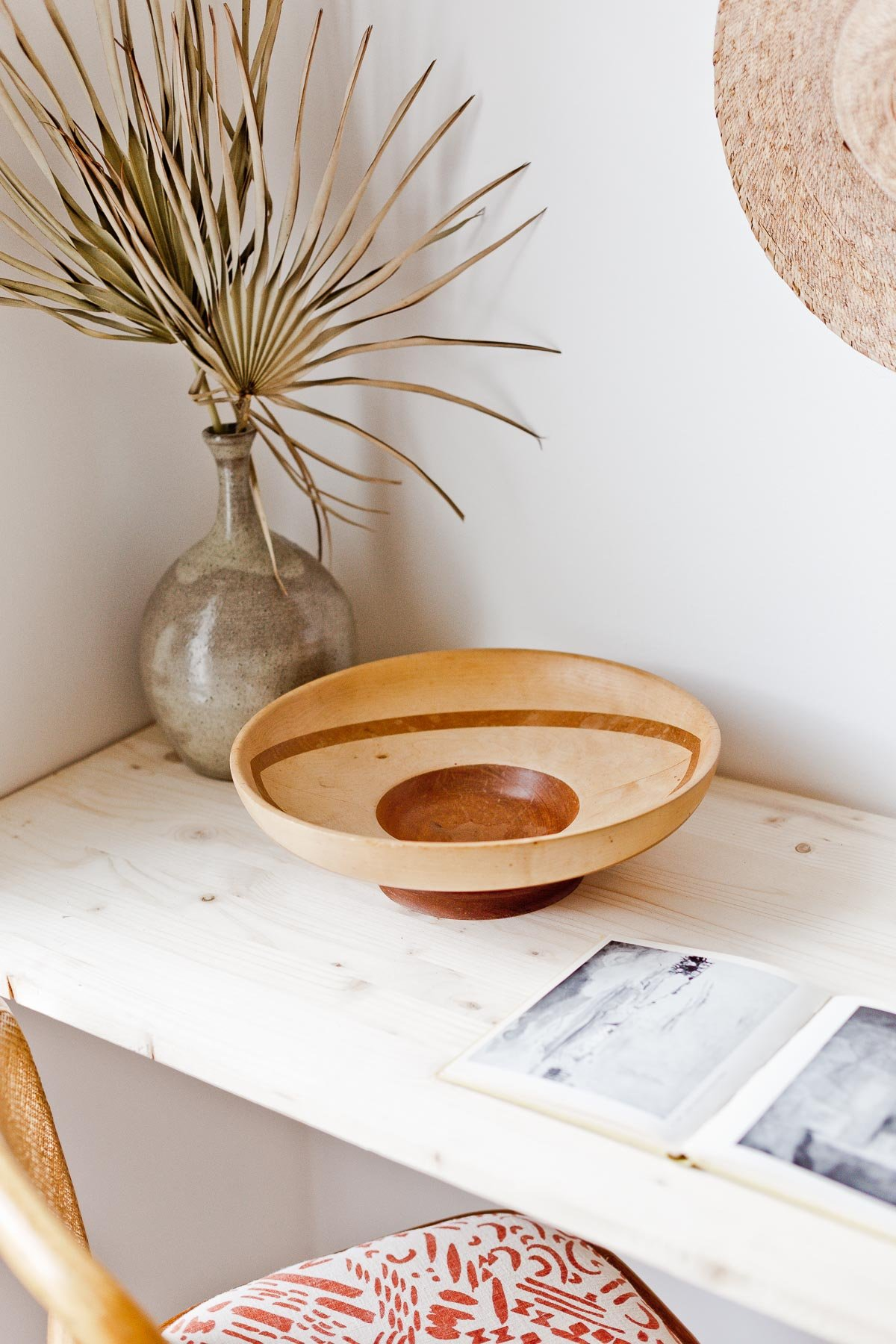 Vintage finds and natural elements are found throughout this earthy modern guest room / home office makeover by Brittni Mehlhoff of Paper and Stitch. #earthyinterior #organicmodern #vintage #deskaccessories