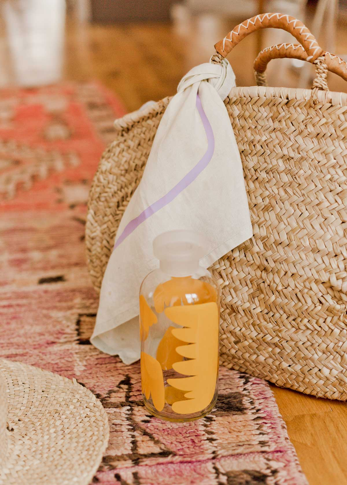 DIY Summer Accessories Idea // Give plain bandanas and an old water bottle new life with a quick (and easy) makeover. Click through for the tutorial AND free downloadable patterns to add unique prints to nearly anything you can think of. #diy #diysummer #summer #summeraccessories