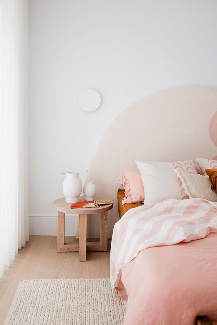 This oversized, arched headboard from Three Birds Renovations is perfection. Maybe I'm crazy, but wouldn't this make an amazing upholstered headboard DIY?! I mean, I did just buy a jigsaw, so I'm kinda obligated to at least try it, right?! #arch #designtrend #interiors #organicmodern #bedroom #pink #headboard #statementheadboard