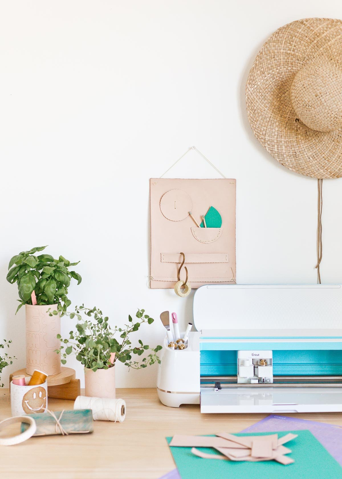 3 Cool (DIY) Things to Make with Leather Right Now. Wanna make something with leather? Try these unique DIY leather ideas that you cane embellish with a Cricut Maker with embossed patterns and more. #leather #diy #leatherdiy #homedecor #workspace #wallorganizer